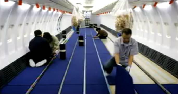 Układanie wykładziny dywanowej. Renton 2011r.