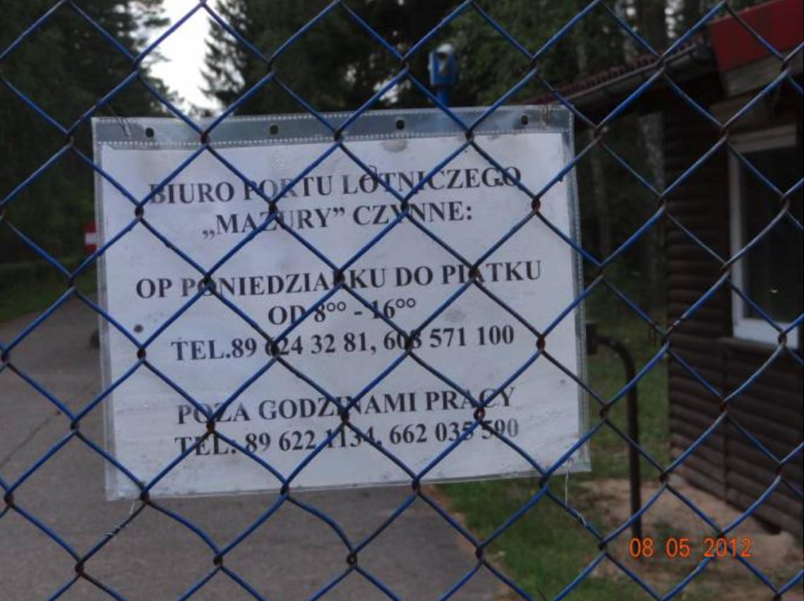 Informacja na głównej bramie wjazdowej. 2012 rok. Zdjęcie Karol Placha Hetman