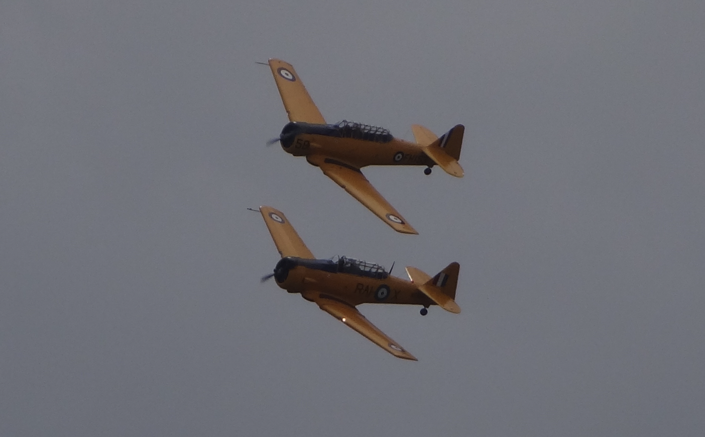 North American AT-16 Harvard IIB nb FH-153/58 and North American T-6 Harvard 4M (RAI-X) nb KF-584. 2018. Photo by Karol Placha Hetman